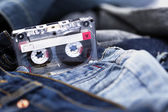 Audio Cassette on Denim — Stock Photo