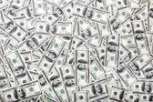 One Hundred Dollar Bills Background - Mess — Stock Photo
