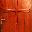 Cross Relief on a Door — Stock Photo