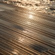 Wet Wooden Deck &amp; Sea - Stock Photo