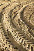 Tire Tracks in the Sand - Surface Level — Stock Photo