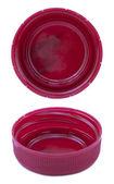 赤ピンクのプラスチック ボトルのキャップの背面側の 2 つの角度 — ストック写真