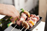 Oiling the Meat — Stock Photo