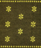 Textura de tecido de algodão - cáqui com padrões amarelos — Foto Stock