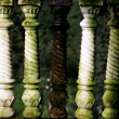 Stock Photo: White to Green Porch Banister Pillars