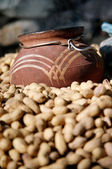Jug and Peanuts — Stock Photo
