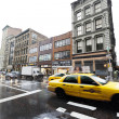 Постер, плакат: Yellow Taxi Traffic in Rainy Broadway Manhattan New York
