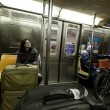 Woman with Suitcase and Cycler in New-York Subway — Stock Photo