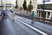 Skaters on a Bridge — Stock Photo