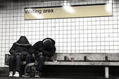 Two Sleeping in NYC Subway Waiting Area — Stock Photo
