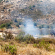Fire in a Palestinian Field by Wall of Separation — ストック写真