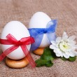 Pair of eggs in bows — Stock Photo