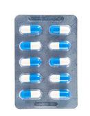 Wit en blauw capsule in transparante blister pack — Stockfoto