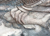 Closedup cement stutue op de muur van de tempel — Stockfoto