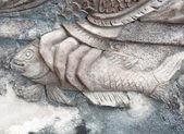 Closedup цемент stutue на стене храма — Стоковое фото
