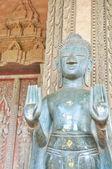 Old metal buddha in Loa temple — Stock Photo