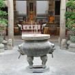 Stock Photo: Incense furnace on buddhbackground