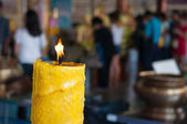 Candle on blur people to pray buddha background — Stock Photo