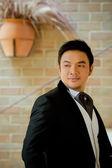 Asian man in black wedding suit — Foto Stock