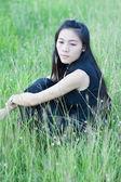 Pretty girl in a spring flower garden — Stock Photo