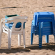 Royalty-Free Stock Photo: Chairs and tables on a beach