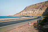 Curved coast road and mountain — Stock Photo