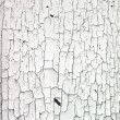 Surface with cracked white paint — Stock Photo