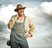 Farmer smiling — Stockfoto