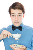 Handsome gentleman with a bow tie, drink tea — Stock Photo