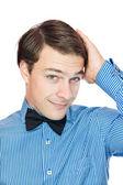 Handsome gentleman adjusting his bow tie — Stock Photo