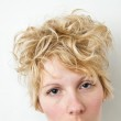 Close-up blond girl looking at the camera - curly hair — Stock Photo #22110199