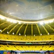 Empty stadium with yellow and blue seats — Stock Photo #22115043