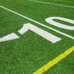 Ten yard line - football with natural lighting — Stock Photo