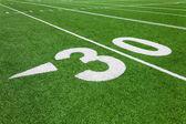 Thirty yard line - football with natural lighting — Stock Photo