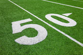 Fifty yard line - football with natural lighting — Stock Photo