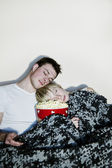 Young couple watching television. — Stock Photo