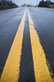 Yellow street lines (double) — Stock Photo