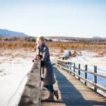 Girl on the bridge in the field — Stock Photo #22419623