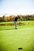 Man playing golf - putting — Stock Photo
