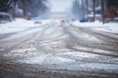Snow-covered road, the marks of wheels — Stock Photo