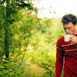 Royalty-Free Stock Photo: Young man in nature with a mug of coffee