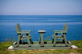 Bench by the sea — Stock Photo
