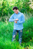 A young man in nature — Stock Photo