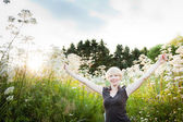 Girl in a field of flowers — Stock Photo