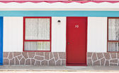 Motel with red and blue doors — Stock Photo