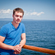 The young man on the deck against the sea — Stock Photo #22707707