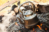 Kettle with water heated on the fire — Stock Photo