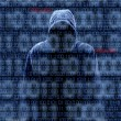 Stock Photo: Silhouette of hacker isloated on black