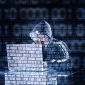 Hacker typing on a laptop — Stock Photo