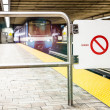 Moving subway train and Motion blur with Safety Interdiction Sig — Stock Photo